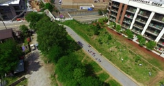 Atlanta Beltline Aerial Track Backward Pan Right Tilt Down Up Over People - stock footage