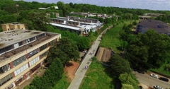Atlanta Beltline Aerial Track Backward Tilt Down Over People Stock Footage
