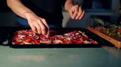 Young woman making a pizza Stock Footage