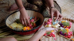 Balinese women making offerings (Canang sari) - stock footage