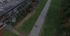 Atlanta Beltline Aerial Track Right Tilt Up Over People Power Line Stock Footage