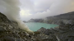 Sulfur acid thick white smoke at Kawah Ijen volcano crater Stock Footage