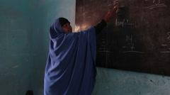 Teacher at Black Board in Somalia Stock Footage