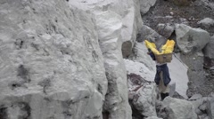 worker carry sulfur walking on volcano crater - stock footage