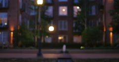 Apartment Building on City Street with Water Fountian Blur to Focus, 4K. - stock footage