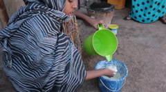 Making Flat Bread in Somalia Stock Footage
