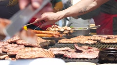 Street food festival of grilled meat  - cooking selling tasty meat dishes Stock Footage