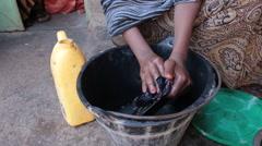 Washing Dishes in Somalia Stock Footage