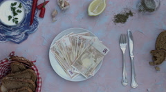 4k food composition on a vintage background with a plate with money Stock Footage