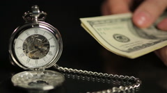 Hands counting money, person calculating savings, time flies on pocket watch - stock footage
