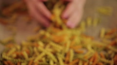 Colorful pasta in hands, Italian cuisine ingredient, healthy wholegrain product Stock Footage