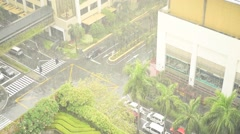 High angle shot of a busy city street during heavy rainfall, rack focus Stock Footage