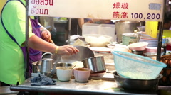 Chef with Wok noodles adding ingredients Stock Footage