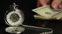 Hands counting US dollars near pocket watch, businessperson calculating profit Stock Footage