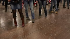 People dancing line dance at country show with USA flag Stock Footage