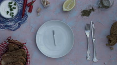4k food composition on a vintage background with a cigarette in a plate Stock Footage