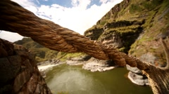 PERU: Inca grass bridge over the river Apurimac in peruvian Andes Stock Footage