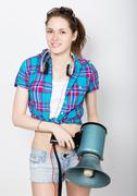 teenager girl in denim shorts and a plaid shirt express different emotions - stock photo