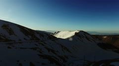 The camera approaches a mountain with snow. Winter Panorama, majesty and ice. N. Stock Footage