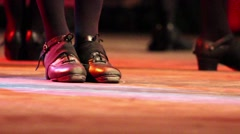 People doing Irish dance on stage with traditional shoes at a folk festival - stock footage