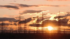 4K TIME LAPSE of moving clouds in front of a sunset and utility poles Stock Footage
