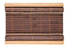 Bamboo mat with curled edges and rope, isolated Stock Photos
