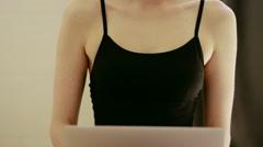 beautiful girl wearing ballet leotard with laptop - stock footage