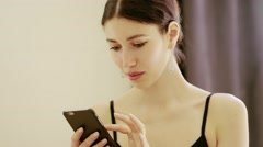 beautiful girl wearing ballet leotard with cellphone - stock footage