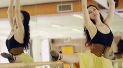 girl posing on one leg at ballet barre - stock footage