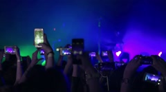 Making party at a rock concert and hold cameras with digital displays Stock Footage