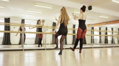two girls are dancing - stock footage