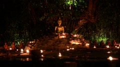 Chiang Mai, Thailand.  Magha puja day. Buddha surrounded by Stock Footage