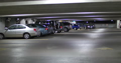 Family Car Driving in Parking Garage at Night, 4K Stock Footage