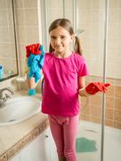 girl with pigtails posing at bathroom while doing cleaning - stock photo