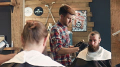 Barber trimming man looking at mirror Stock Footage