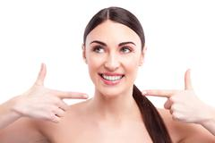 Cheerful woman is proud of her face - stock photo