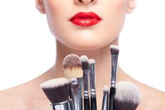 Pretty young woman is ready for beautification - stock photo