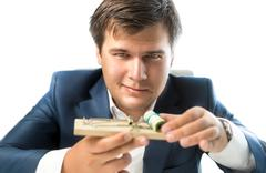 banker offering risky investment. Man holding mousetrap with money - stock photo