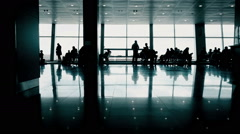 Travelers expecting plane in airport waiting hall, people walking with suitcases - stock footage