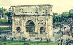 Triumphal arch near Coliseum Stock Photos