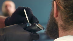 Close-up of man's beard being groomed - stock footage