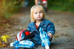 Little girl on roller skates Stock Photos