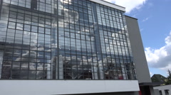 Bauhaus Dessau: School building with gorgeous reflection in massive glass facade Stock Footage