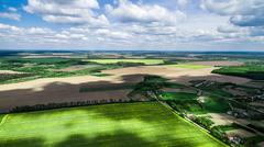 Beautiful landscape with shade of clouds on the field Stock Photos