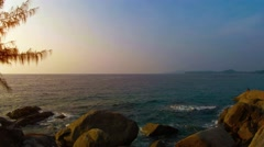 Late Afternoon Sun over a Rocky Tropical Seascape. Video 4k 2160p Stock Footage