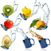 Fruits and vegetables with water splash Stock Photos