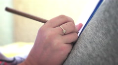Hand with pencil write on notebook, closeup Stock Footage