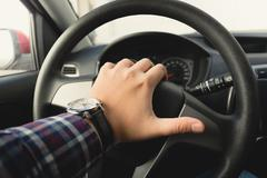 toned photo of male driver honking the horn - stock photo