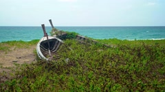 Tropical Seascape with Abandoned Wooden Boats Rotting in the Sand in Thailand - stock footage