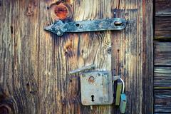 ancient locks on wooden door, abstract textural view - stock photo